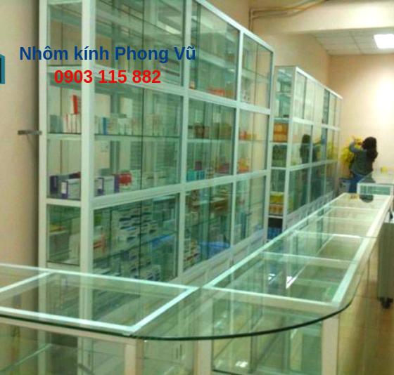Thi công bộ tủ thuốc bằng nhôm kính màu trắng sứ cửa hàng thuốc chị Nga, Dĩ An, Bình Dương